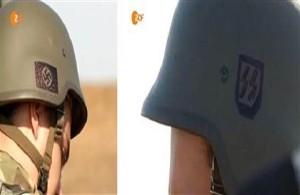 Insignes nazis sur les uniformes des soldats du bataillon Azov de l'armée de Kiev