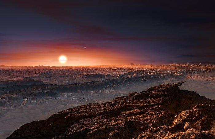 Cette représentation d'artiste montre une vue de la surface de la planète Proxima b en orbite autour de la naine rouge Proxima du Centaure, l'étoile la plus proche du Système Solaire. Le système d'étoiles double Alpha Centauri AB figure dans l'angle supérieur droit de l'image. Proxima b est dotée d'une masse légèrement supérieure à celle de la Terre et décrit une orbite autour de Proxima Centauri, au sein même de la zone d'habitabilité de cette étoile, de sorte que sa température de surface est compatible avec la présence d'eau liquide. Crédit: ESO/M. Kornmesser